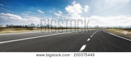 blurred empty asphalt road with cityscape of hangzhou in cloud sky
