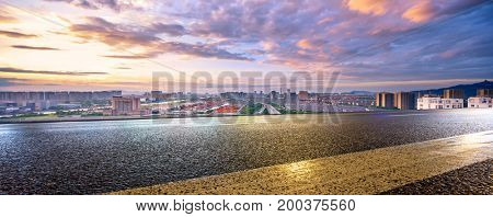 empty asphalt road with cityscape of hangzhou in colorful cloud sky
