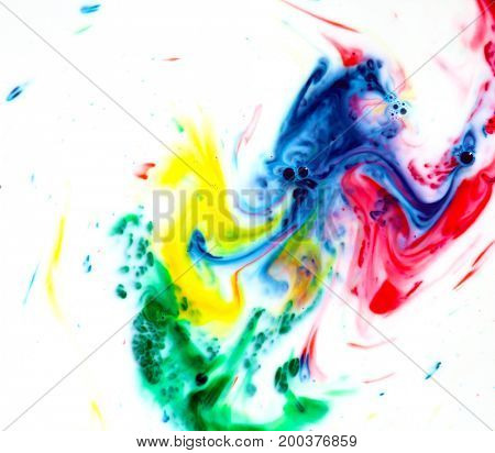 Abstract colors, backgrounds and textures.  Food Coloring in milk. Food coloring in milk creating bright colorful abstract backgrounds. Colorful chemical experiment.