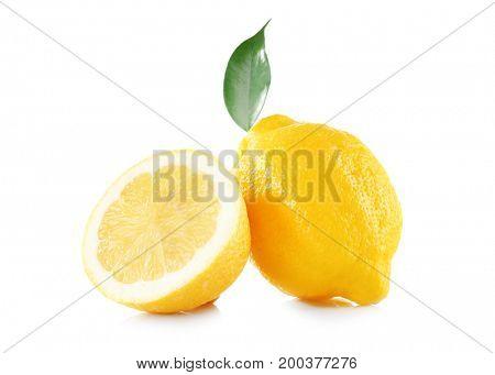Delicious fresh lemons and leaf on white background