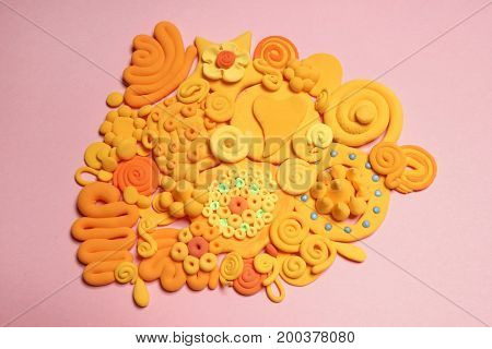 Color plasticine. Creative. Color plasticine on a pink background