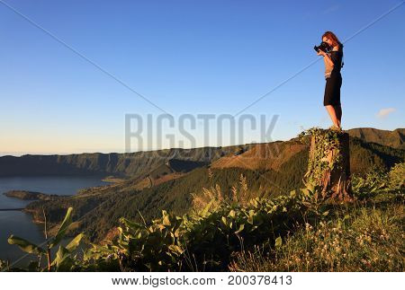 Photographer taking pictures at sunset, Sete Cidades, Sao Miguel Island, Azores, Portugal, Europe