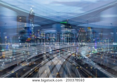 Motion blurred moving train with bokeh city building light night view abstract background