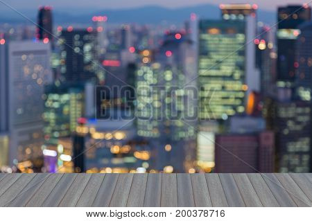 Opening wooden floor Night blurred bokeh light Osaka city busienss downtown abstract background Japan