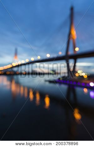 Twin suspension bridge blurred bokeh light at twilight abstract background