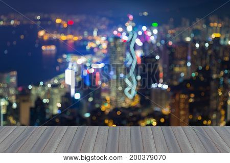 Opening wooden floor Blurred bokeh light Hong Kong downtown abstract background