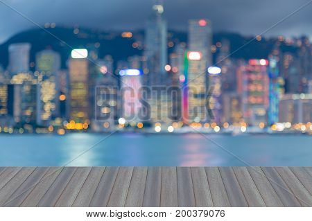 Opening wooden floor Blurred bokeh light Hong Kong city downtown at twilight abstract background
