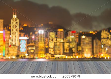Opening wooden floor Hong Kong business downtown blurred bokeh light night view abstract background