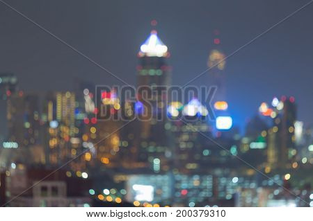 Night blurred bokeh ligth city office downtown abstract background