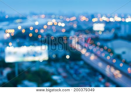 Nigh blurred bokeh light city highway and downtown abstract background