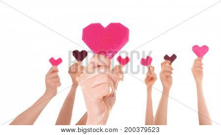 People putting hands in air together with little hearts on white background. Volunteering concept