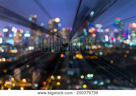Double shot of motion blurred train moving over night city light bokeh abstract background