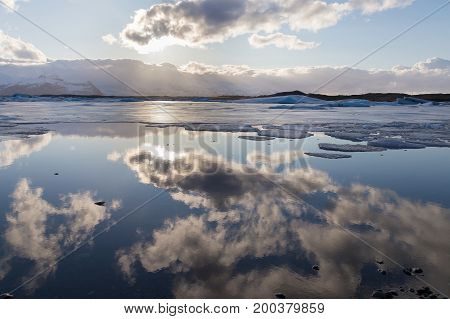 Beautiful Iceland winter season lake with sky reflection natural landscape background