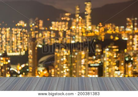 Opening wooden floor Blurred bokeh light Hong Kong crowd apartment over high hill abstract background