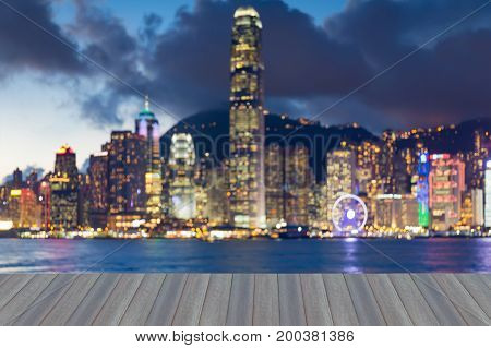 Opening wooden floor Hong Kong city downtown blurred bokeh light at twilight abstract background
