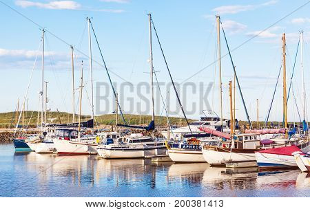 AMBLE, UNITED KINGDOM - AUGUST 7, 2012: Yachts moored at Amble Marina on the banks of the River Coquet in the unspoilt Northumberland countryside of England.
