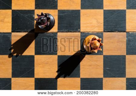 top view Chess Queens stand on chessboard with shadows