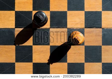 top view Chess Kings stand on chessboard with shadows