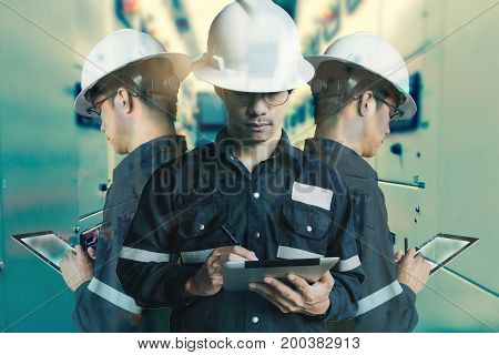Double exposure of Engineer or Technician man working with tablet in switch gear electrical room of oil and gas platform or plant industrial for monitor process business and industry concept.