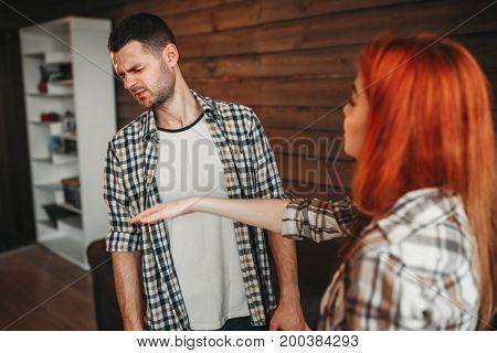 Man and woman quarrel, agressive couple