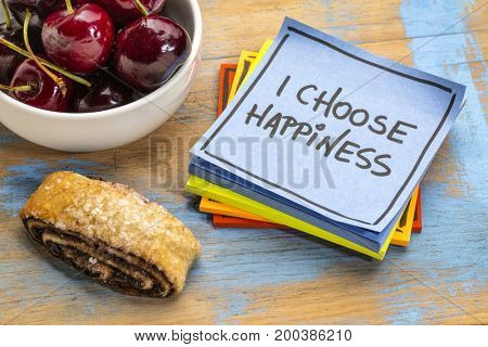 I choose happiness positive affirmation - handwriting on a sticky note with cherries and cookie