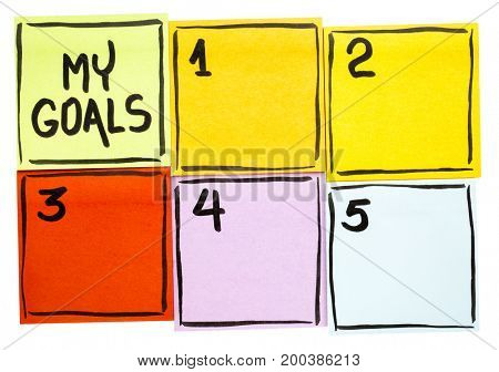 My goals list - handwriting in black ink on  isolated sticky notes