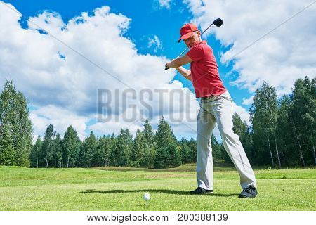 golfer in golf field with club