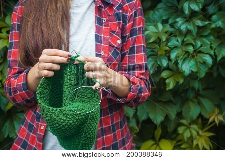 Woman Knits  Sweater In Outdoor