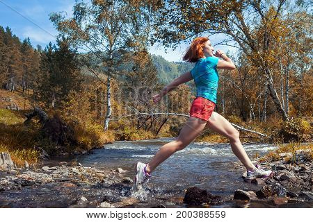 Woman Runs Down A Mountain River