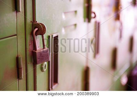 Old lock on the Locker. lock on the door of an old Locker vintage style close-up focus on lock.