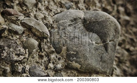 Large stone in a concrete wall. Macro photography.