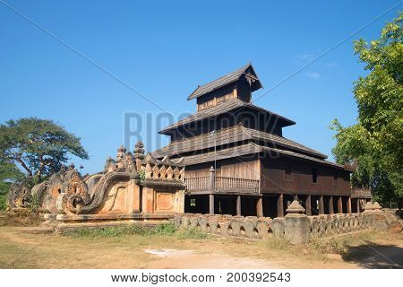 Ancient wooden Buddhist temple on a sunny afternoon. Old Bagan, Burma