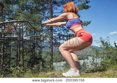 Woman  Makes A Squatting