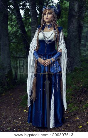 Valkyrie warrioress in magpie costume. Styling for the Scandinavian women's costume of the Viking Age.