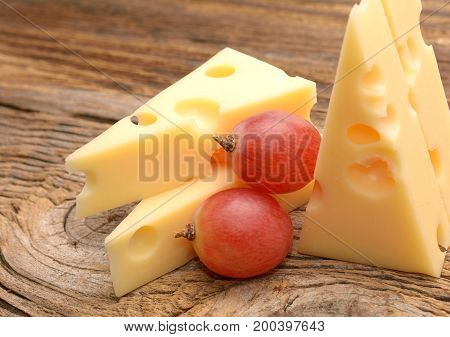 Cheese isolated on wooden board in studio