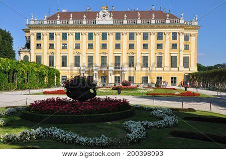 Vienna, Austria - August 2012: View to Schönbrunn Palace in Vienna Austria, with people walking through the huge gardens, in June 2012