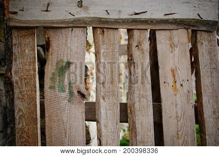 Close Up Background Of Vertical Fence Of Light Wooden Planks That Nailed With Fasteners And Have Cra