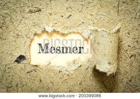 Text Mesmer on paper Orange has Cotton yarn background you can apply to your product.