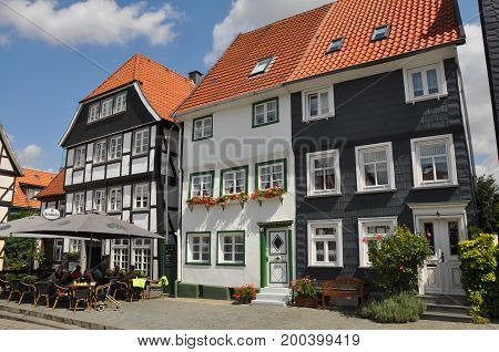 Soest, Germany - August, 2012: Typical architecture of western Germany, houses of Soest, with people sitting in a cafe outside, in August 2012