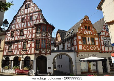 Limburg, Germany - August 19, 2012: Half-timbered houses with shops on a public square in Limburg, Germany, in August 2012.