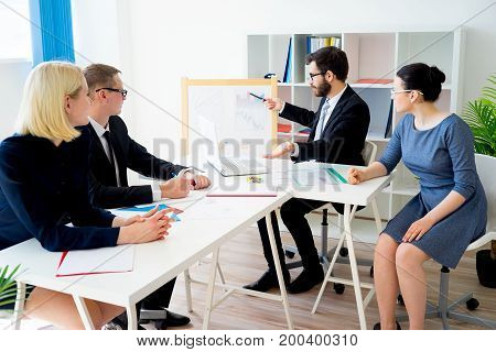 A businessman is presenting something at a meeting
