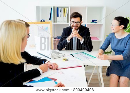 A business meeting is in progress at office