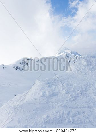 Beautiful mountains snow and skiers high in the mountains in Sochi Russia