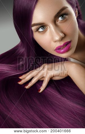 beautiful young woman with long healthy shiny hair. copy space. isolated on white background. red lips.