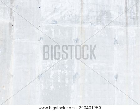 Old light gray concrete wall with a rough surface and smudges