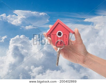 The Architecture building househomeconstruction real estate and property concept - close up of hands holding house or home model.Female hand holding house keyreal estate agent.