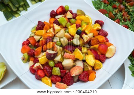 Salad with fresh fruits and berries. Bowl of healthy fresh fruit salad.