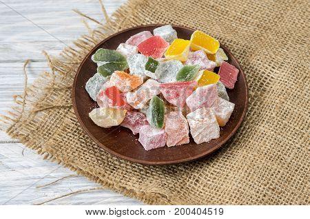 Multicolored Marmalade In A Clay Plate.