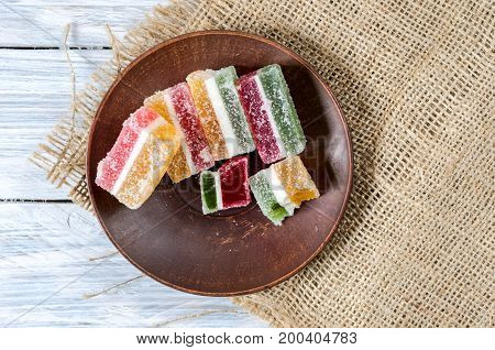 Sweets On A Clay Plate. Jelly Sweets. Multicolored Sticks.