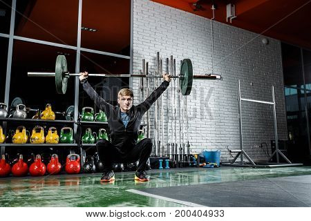 Barbell Exercises. Workout In Dark Gym
